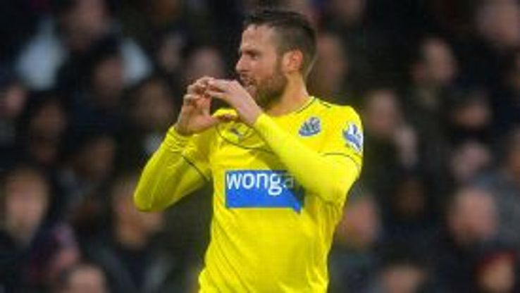 Yohan Cabaye scored Newcastle's first goal at a soggy Crystal Palace.