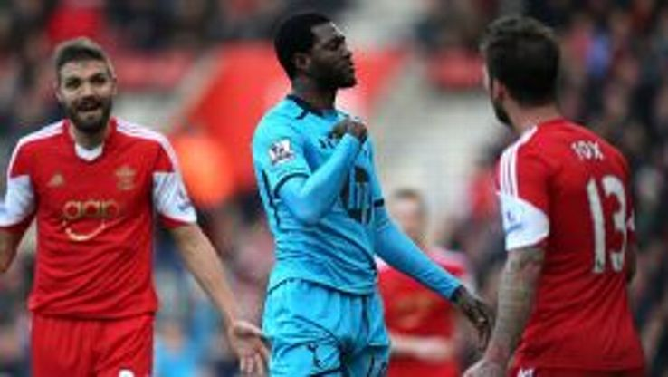 Emmanuel Adebayor celebrates scoring an equalising goal to make it 1-1