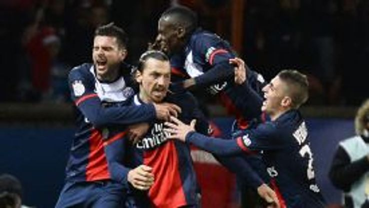 Zlatan Ibrahimovic is mobbed after giving PSG the lead, but they would have to come from behind to draw with Lille.