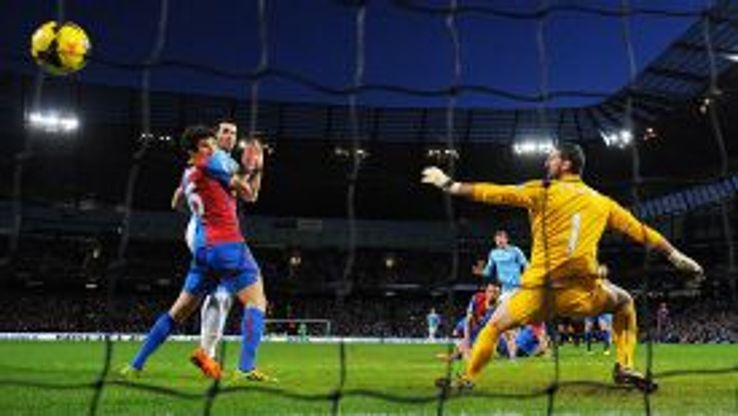 Edin Dzeko rifles home to give Man City the points against Crystal Palace.