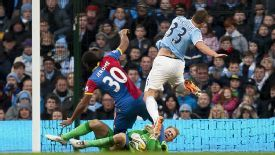Joe Hart gets Cameron Jerome's boot in his face during Man City's hard-fought victory over Crystal Palace.