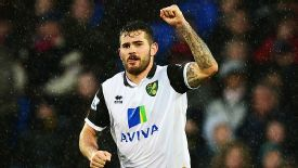 Bradley Johnson celebrates after giving Norwich the lead at Crystal Palace.