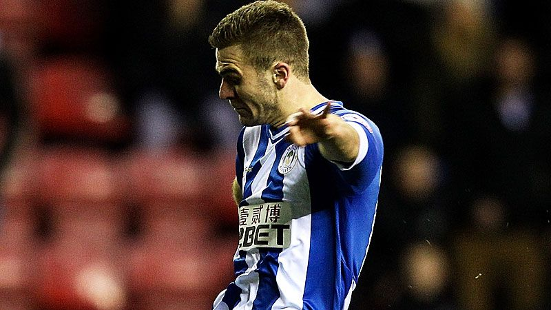 Callum McManaman, who scored his side's third goal, in action against MK Dons