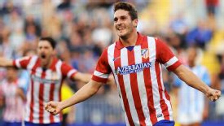 Koke celebrates after scoring the winner at Malaga.