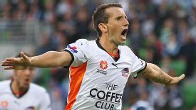 Liam Miller celebrates after scoring the first goal in Brisbane Roar's win at Melbourne Victory.
