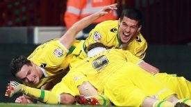 Ryan Flynn is mobbed after he scored Sheffield United's shock winner at Aston Villa.