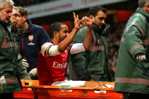 Theo Walcott wasn't popular among the travelling Spurs fans after responding to jeers by signalling the score.