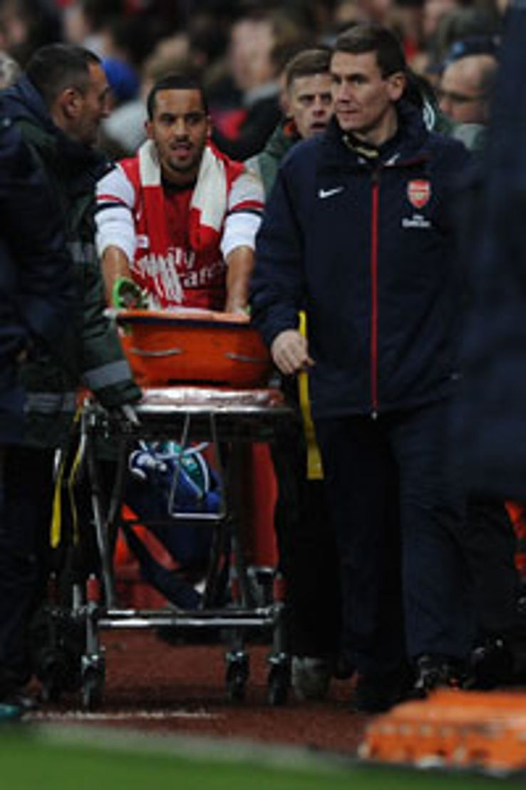 Theo Walcott was stretchered off during the 2-0 win against Spurs with a knee problem.