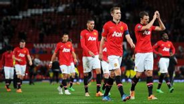 Darren Fletcher leads off a dejected group of Man United players.