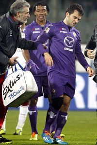 Fiorentina striker Giuseppe Rossi is helped off the pitch after suffering another suspected cruciate injury.
