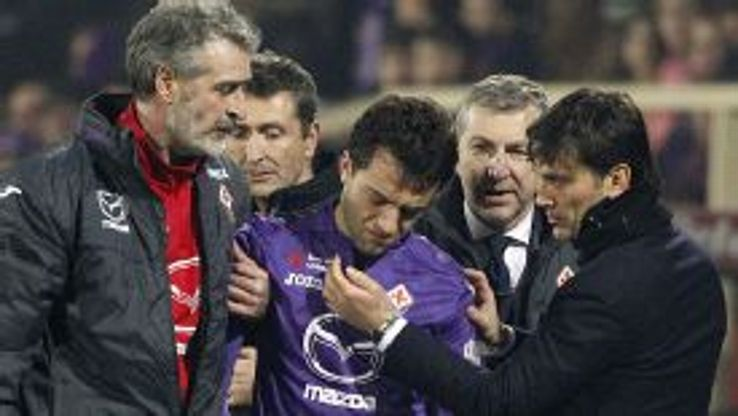Fiorentina coach Vincenzo Montella tries to comfort Giuseppe Rossi as he is helped off the pitch after suffering another suspected cruciate injury.