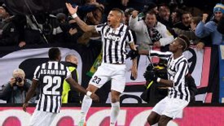 Arturo Vidal jumps for joy after giving Juventus the lead at home to AS Roma.