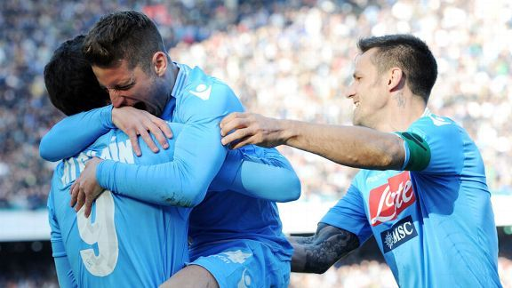 Dries Mertens celebrates one of his strikes with his Napoli teammates.