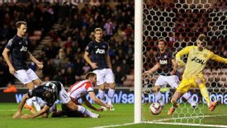Ryan Giggs puts the ball into his own net under pressure from Phil Bardsley.