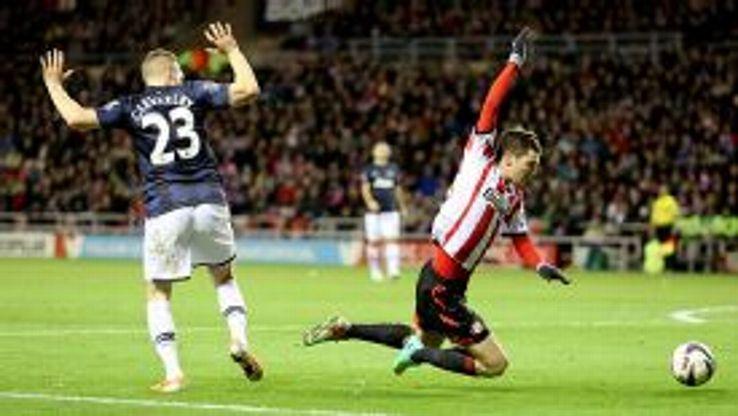 Tom Cleverley fouls Adam Johnson for Sunderland's penalty kick.