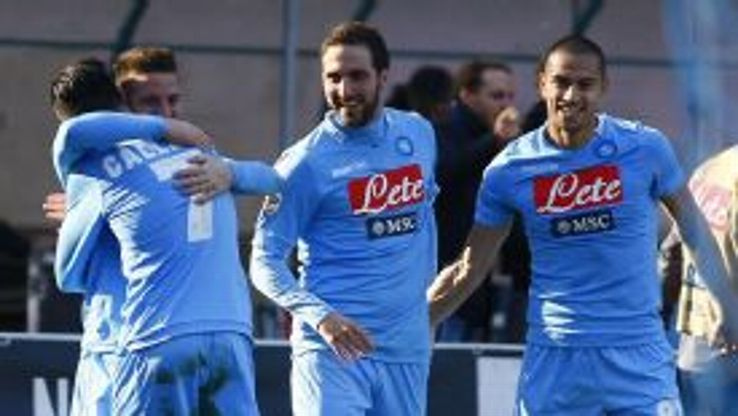 Gonzalo Higuain (C) feels Napoli could yet make up the gap on Serie A leaders Juventus.
