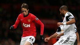 Adnan Januzaj surges forward for Manchester United against Swansea.