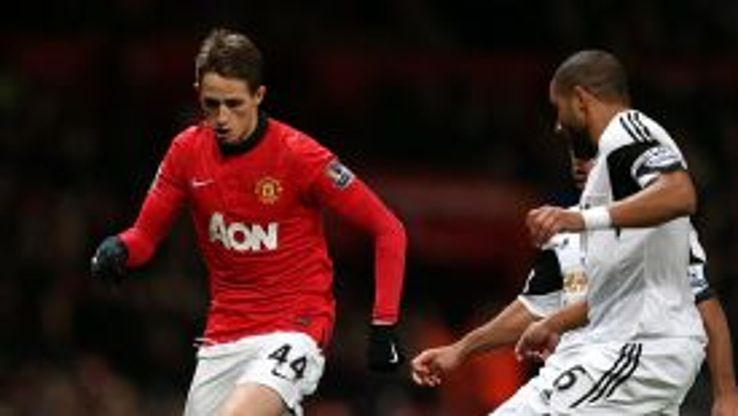 Adnan Januzaj surges forward for Manchester United against Swansea.