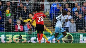 West Ham United's Carlton Cole scores opening goal against Cardiff