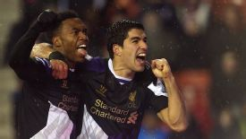 Daniel Sturridge and Luis Suarez celebrate the latter's curled finish.
