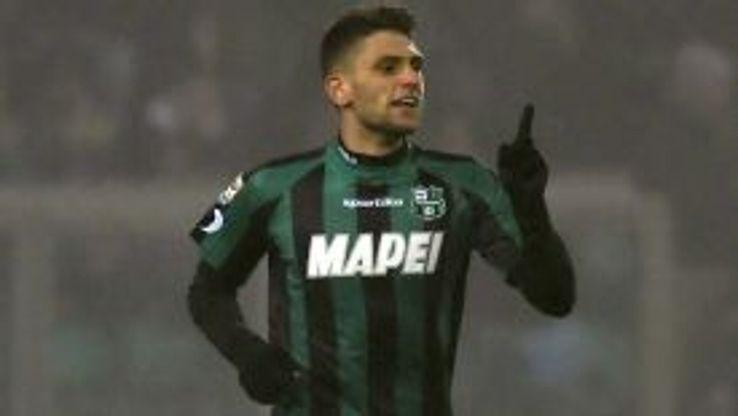 Domenico Berardi celebrates after scoring one of his four goals against AC Milan.