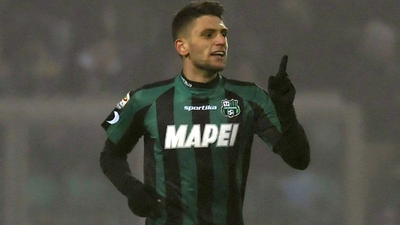 Domenico Berardi celebrates after scoring against AC Milan.