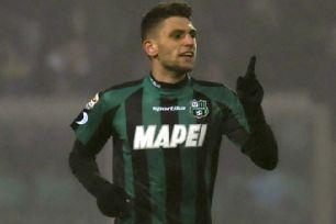 Domenico Berardi celebrates after scoring against AC Milan.