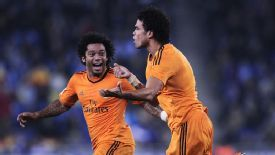 Pepe and Marcelo wheel away after the centre-back's goal against Espanyol.