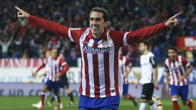 Diego Godin celebrates after putting Atletico Madrid on their way to victory against Valencia.