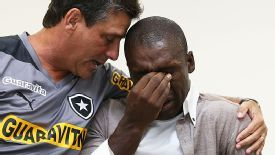 An emotional Clarence Seedorf is embraced by Botafogo coach Eduardo Hungaro as he says his goodbyes.
