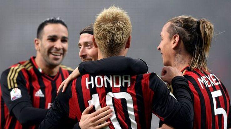 Keisuke Honda celebrates his first AC Milan goal.