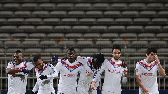 Lyon celebrate Bafetimbi Gomis' goal, which took them through against Marseille.