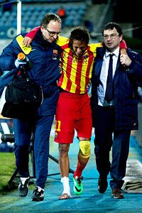 Neymar leaves the pitch at Getafe with his ankle strapped up after suffering a suspected sprain.