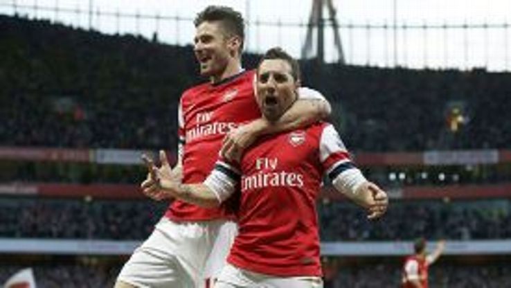 Goalscorer Santi Cazorla celebrates with Olivier Giroud after scoring Arsenal's first against Fulham.