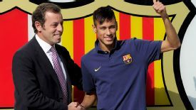 Rosell and Neymar pose after the Brazilian signed a five-year deal with Barcelona in 2013.