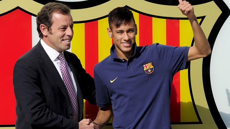 Sandro Rosell and Neymar pose after the Brazilian signed a five-year deal with Barcelona in 2013.