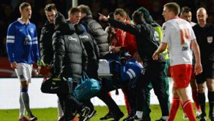 Brian Oviedo is stretchered off after suffering injury.