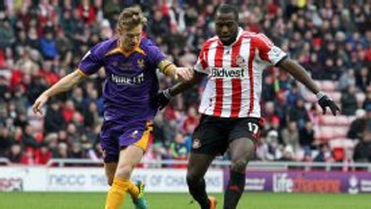 Jozy Altidore of Sunderland (R) shields the ball from Kyle Storer of Kidderminster