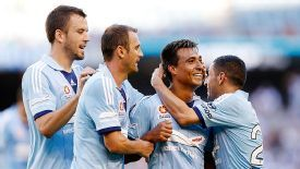 Sydney FC celebrate their 5-0 victory over Melbourne Victory.