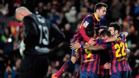 Pedro celebrates his goal for Barcelona with teammates.