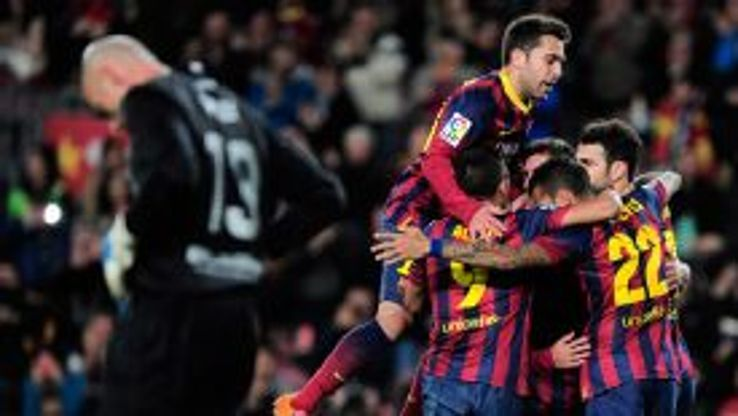 Pedro celebrates his goal for Barcelona with teammates.