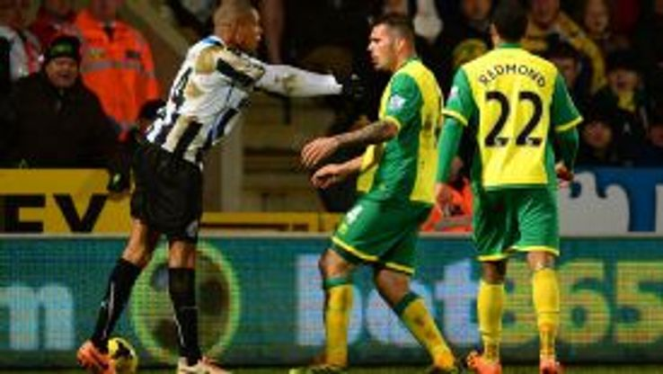 Loic Remy and Bradley Johnson were both sent off for an altercation as Norwich and Newcastle shared the spoils.
