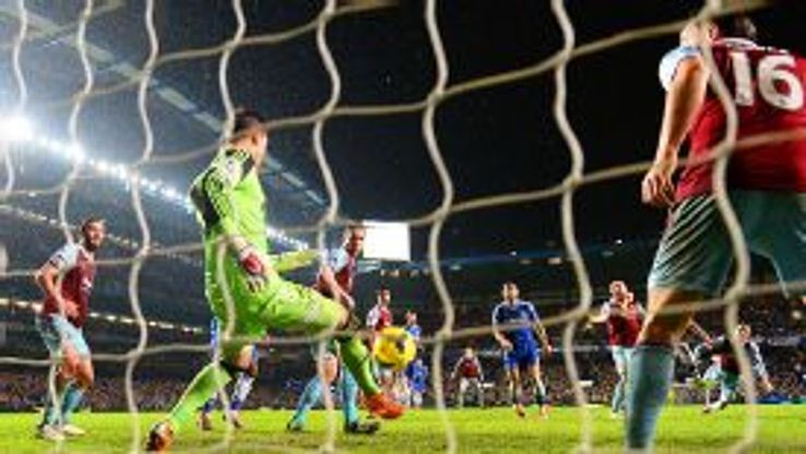 Adrian saves from a John Terry header.