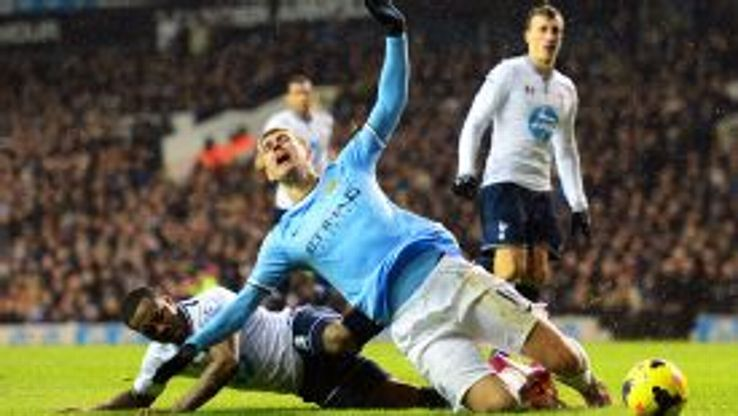 Danny Rose fouls Edin Dzeko for a penalty - which also saw the Spurs defender dismissed.