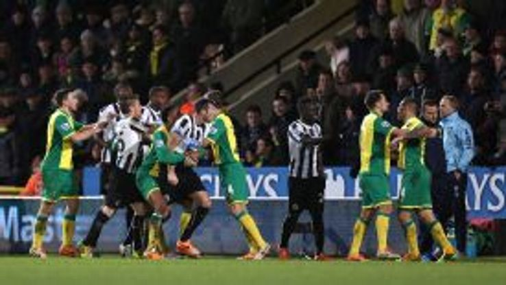 Loic Remy and Bradley Johnson are separated by their teammates after clashing.