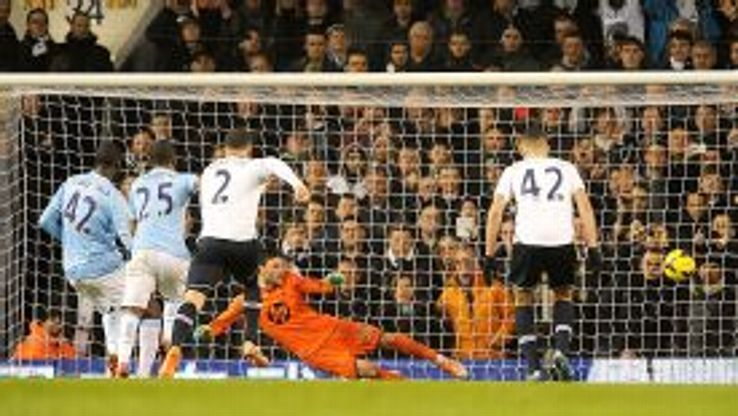 Yaya Toure scores from the penalty spot at Spurs.