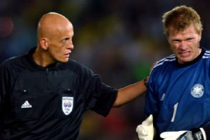 Referee Pierluigi Collina (l) checks the condition of Germany goalkeeper Oliver Kahn in the 2-0 defeat by Brazil in the 2002 World Cup final, on June 30.