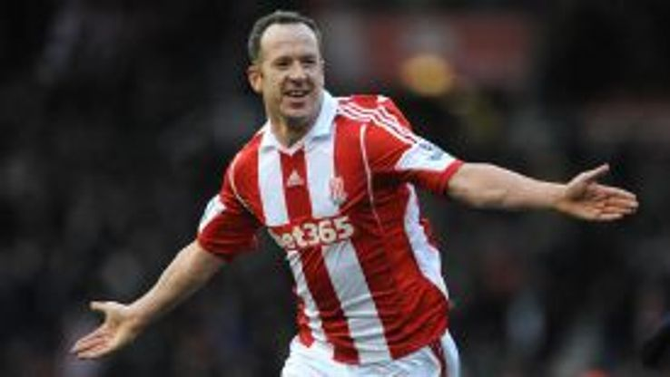 Charlie Adam wheels away after seeing his free-kick deflect home against United.
