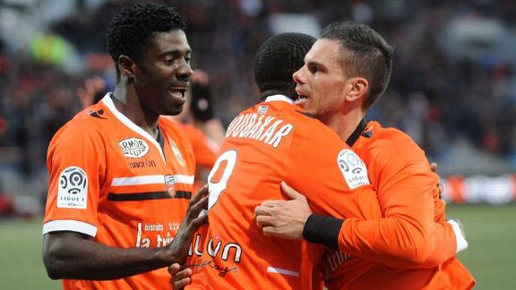 Jeremie Aliadiere celebrates his goal against Monaco with his Lorient teammates.