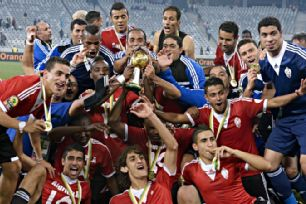 Libya celebrate with the trophy after winning the African Nations Championship.